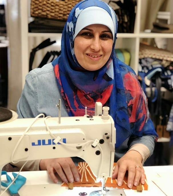 renew refugee women making handmade product