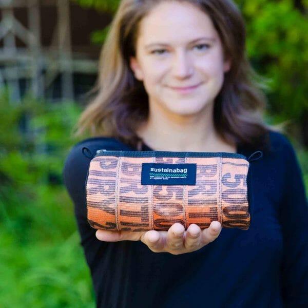 Woman holding Sustainabag product
