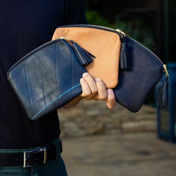 Man fanning out three maudernise pouches