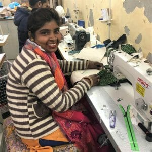 woman in striped sweater at sew mach