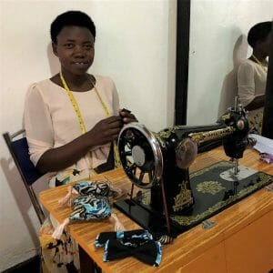 woman in tan blouse at sew mach