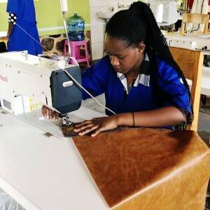 woman sewing brown vinyl