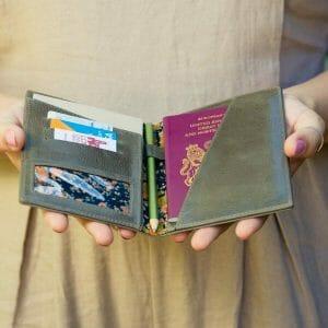 Woman holding open passport holder