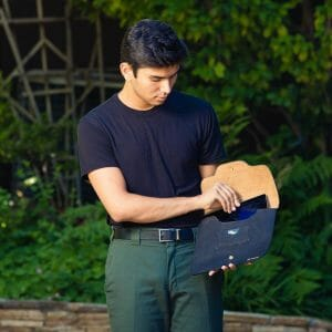 man pulling ipad out of sleeve