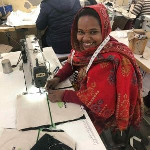 woman in headscarf at sewing mach 1